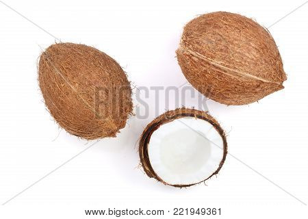 whole coconut with half isolated on white background. Flat lay. Top view.