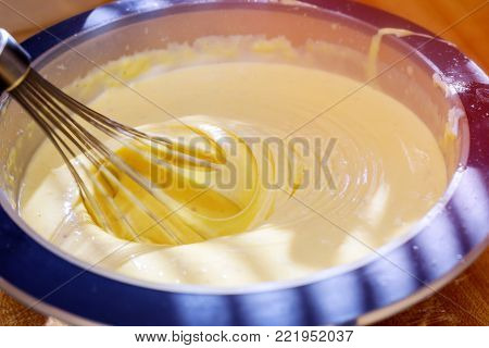 The process of whipping cream with a mixer. Mixer whiskers with cream. Soft focus. Close-up.