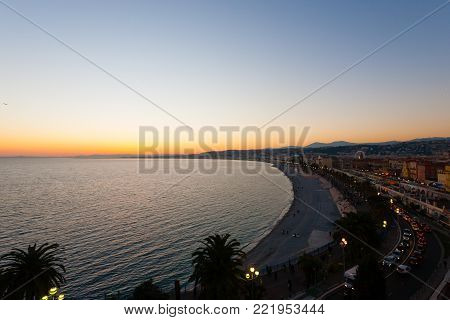Nice beach day landscape, France.  Nice beach and famous Walkway of the English, Promenade des Anglais. Famous French touristic town