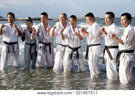 KAGAWA, JAPAN - JANUARY 3, 2018,: Japanese martial arts training of karate in midwinter of a new year at Ichinomiya Beach, Kagawa, Japan.