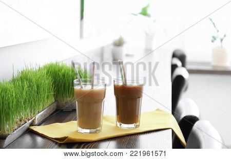 Glasses with protein shake on counter in sport bar