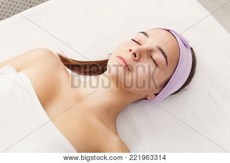 Woman in spa wait for procedure. Girl in beauty parlor closeup side view portrait