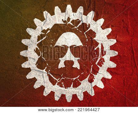 Demonic ugly face. Evil man portrait in gear frame. Grunge texture