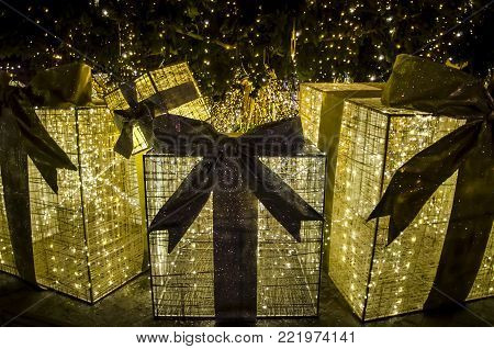 LVIV, UKRAINE - DECEMBER 18: Golden Christmas and New Year gifts under the Christmas tree in the center of Lviv on December 18, 2017 in Lvov, Ukraine