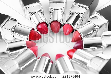 Lipsticks of different shades on white background