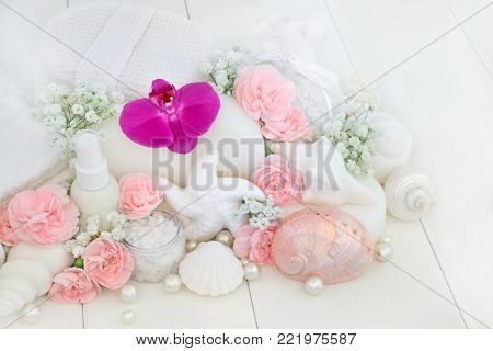 Beauty treatment cleansing and ex foliation products with orchids and carnation flowers, ex foliating salt, body lotion, seashell soaps, sponges, wash cloths, decorative shells and pearls.