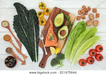 Brain health food nutrition concept with fish, vegetables, seeds, pollen grain and herbs on rustic  background. Foods high in vitamins, minerals, antioxidants, anthocyanins and omega 3.