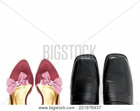 part of purple high heels shoes with ribbon bow and black leather shoes with copy space for text isolated on white background, fashion lovers concept, flat lay close-up top view
