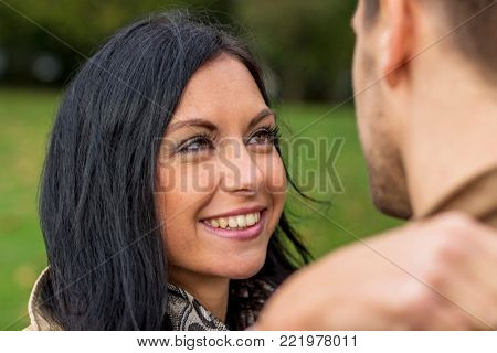 amorous couple in a park
