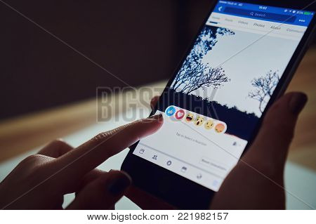 Bangkok, Thailand - January 15, 2018 : hand is pressing the Facebook screen on apple iphone6 ,Social media are using for information sharing and networking.