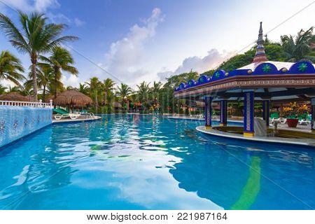 PLAYA DEL CARMEN, MEXICO - JULY 10, 2011: Luxury swimming pool scenery at RIU Yucatan Hotel in Playa del Carmen, Mexico. RIU Hotels & Resorts has more than 100 hotels in 19 countries.