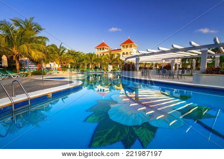 PLAYA DEL CARMEN, MEXICO - JULY 11, 2011: Scenery of luxury swimming pool at RIU Palace Hotel in Playa del Carmen, Mexico. RIU Hotels & Resorts has more than 100 hotels in 19 countries.