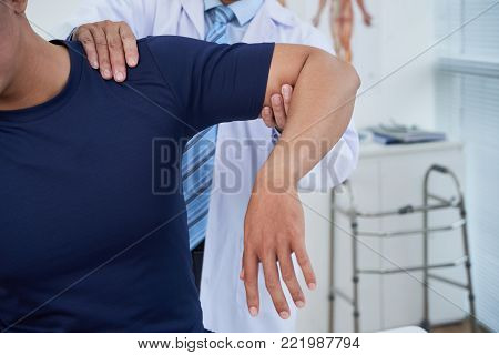 Man having course of rehabilitation therapy in hospital
