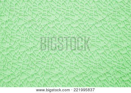 Background emerald delicate lace. Gentle texture fabric close. Cloth weave decorative. Textile weave patterned.