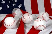 baseballs on an American flag showing seams double exposed poster