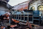 Ruined abandoned electrical substation. Rusty generator at machinery. Demolished roof. Gagra, Abkhazia poster