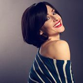 Sexy sensual woman with short bob hair style with closed eyes, red lipstick touching her face on dark shadow background. Closeup art portrait. Black and white poster