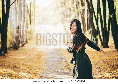 Dreamy Dancing Girl With Long Natural Black Hair On Autumn Background With Trees And Yellow Leaves I