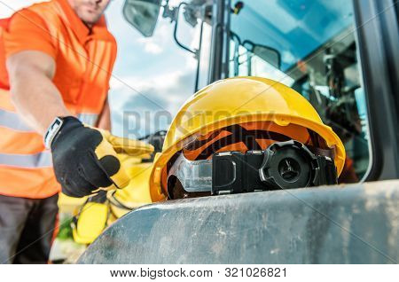 Hard Hat Industrial Zone. Caucasian Worker And Yellow Head Safety Helmet. Construction Industry Them