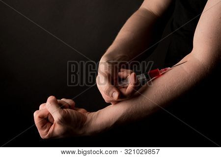 Man Injecting With Substance In Syringe. Drug Abuse Concept. Sports Doping.