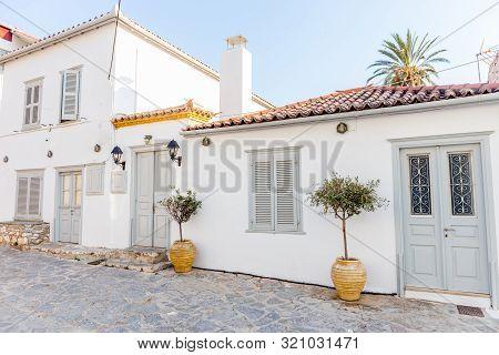 Greek White Housem, Narrow Traditional White Street In The Town Of Hydra, Hydra Island, Greece