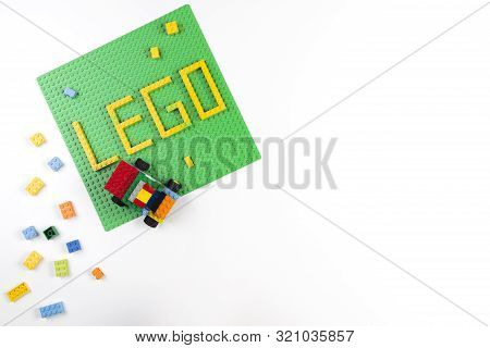 Vilnius, Lithuania - 17 August, 2019: Word Lego On Green Baseplate And Colorful Lego Blocks On White