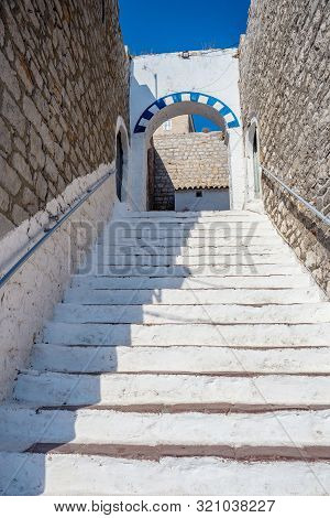 White Steps. Narrow Traditional White Street In The Town Of Hydra, Hydra Island, Greece