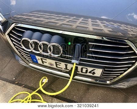 An Audi A3 E-tron Plug-in Hybrid Car Charging In The Streets Of Leipzig, Germany.