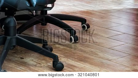 Detail Of Two Office Chairs Casters Wheels On A Wooden Floor