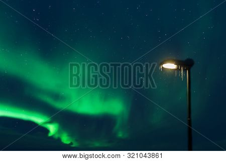 Street Lamp Covered In Snow With Northern Lights Aurora Borealis In The Background, Tromso, Norway