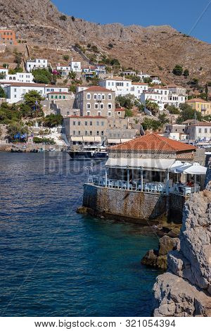 Hydra, Greece - 16 August 2019: Picturesque View At A Restaurant In Port Town Of Hydra Island In Gre