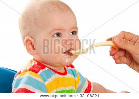 Little Baby Is Feeding Curds From Spoon