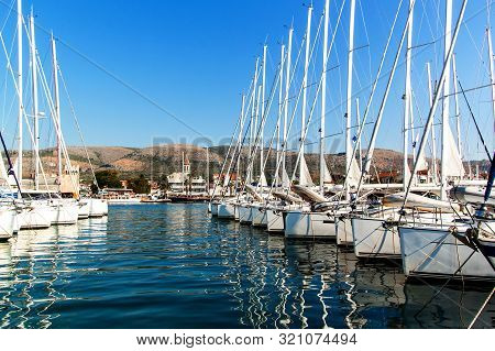 Summer Morning In The Harbor. Yachts Parking In Harbor, Harbor In Trogir, Croatia. Sailboats Reflect
