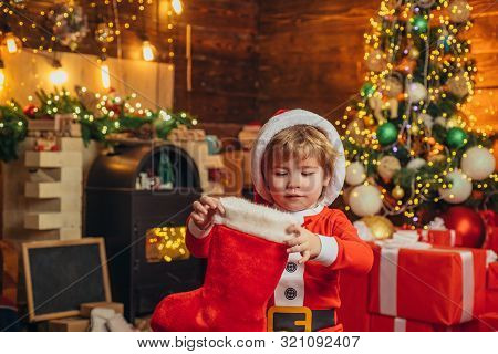 Oh Happy Day. Christmas Stocking Concept. Child Cheerful Face Got Gift In Christmas Sock. Contents O