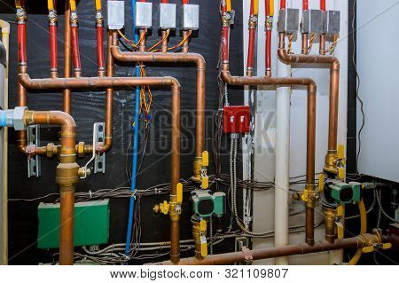 Heating systems copper pipes with ball valves on pipes collector of underfloor heating system pump and pipes poster