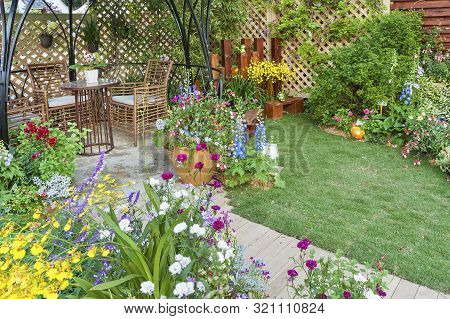 Lush Landscaped Backyard Flower Garden Of Residential House