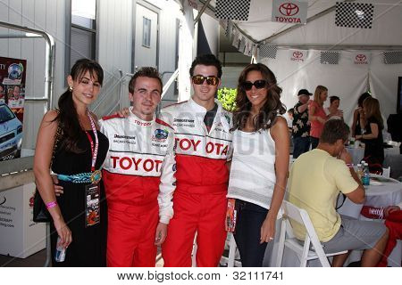 LOS ANGELES, CA - APR 16: Elycia Turnbow, Frankie Muniz, Kevin Jonas & Wife Danielle at the Toyota Grand Prix Pro Celeb Race at Toyota Grand Prix Track on April 16, 2011 in Long Beach, California