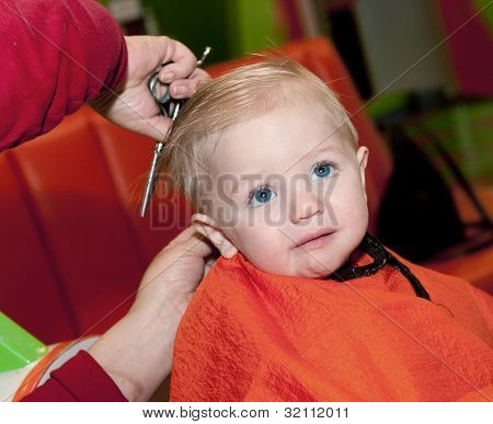 Baby boy's first haircut and he doesn't like it poster