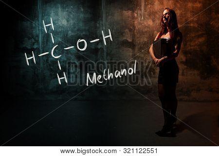 Sexy Girl Or Secretary Or Female Student Presenting Handdrawn Chemical Formula Of Methanol
