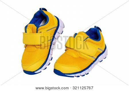 poster of Child shoe fashion. Close-up of a pair of yellow blue child sneaker or sport shoes isolated on a white background. Elegant and trendy shoes for girls. Macro.