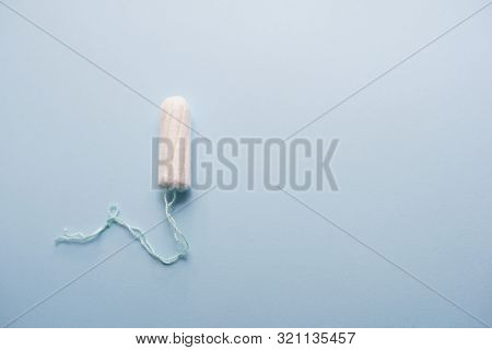 Hygienic Tampon On A Blue Background. Copy Space