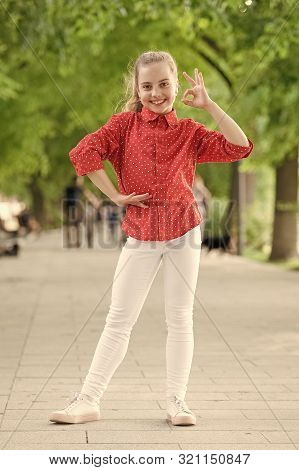 Her Vacation Is Ok. Small Girl Enjoying Vacation Time In Summer Park. Cute Child With Long Blond Hai