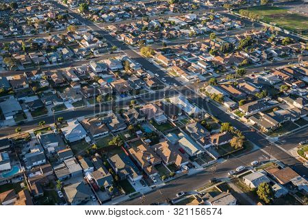 Morning aerial view residential homes and streets near Hawthorne in Los Angeles County, California.