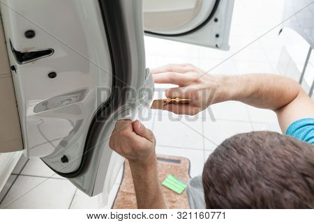 Retrofitting The Car With A Solid Transparent Protective Film, The Master Smooths The Surface By Squ
