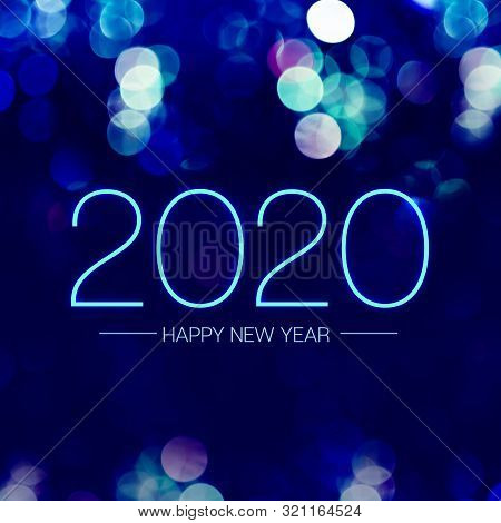 Happy New Year 2020 With Blue Bokeh Light Sparkling On Dark Blue Purple Background,holiday Greeting