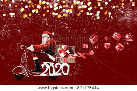 Santa Claus on scooter delivering Christmas or New Year 2020 gifts at snowy red background