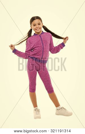poster of Working out with long hair. Girl cute kid with ponytails wear sport costume isolated on white. Stay comfortable with long hair during sport classes. Deal with long hair while sport exercising.