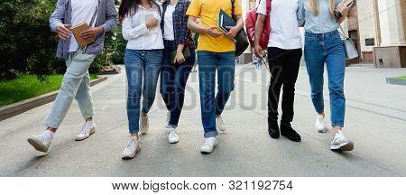 College Students In High School Campus Walking During Break, Focus On Legs, Crop