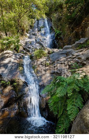 Serra Do Espinhal, Portugal - August 31, 2019 : Waterfall Pedra Ferida, Coimbra, Portugal