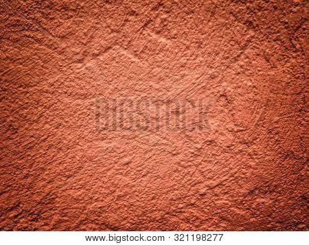 Texture of old dark orange plaster, peeling wall. Obsolete brown cracked background with vignette. poster